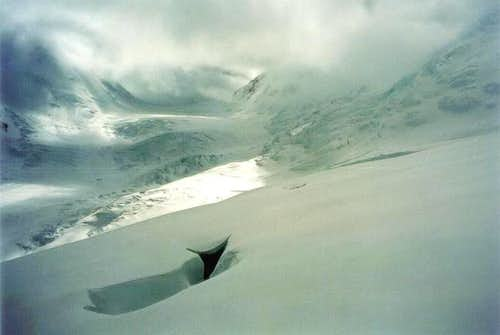 A snow covered crevasse on...