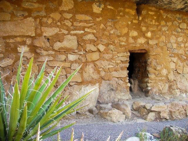 Ruin door and a yucca