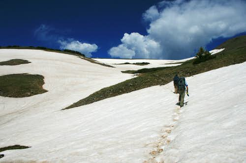 crossing the first snowfield below Tobacco Lake
