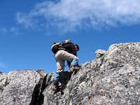 Scrambling up the summit block of Tszil Mountain.