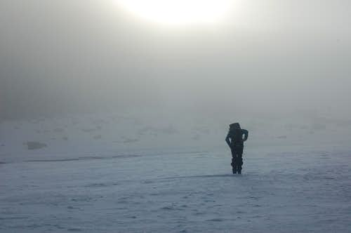 Approaching Store Tverråtind (2309m) from Svellnosbrean Glacier in white-out conditions