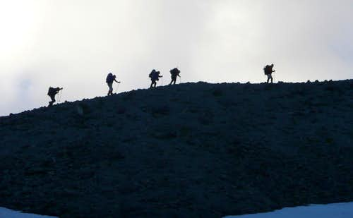 Climbers hiking the...