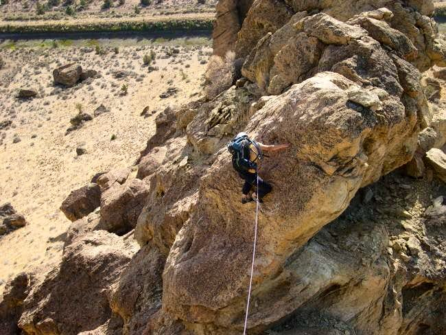 Shirley downclimbing from the...