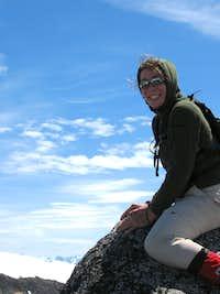 Chelsea straddling the summit of Tszil Mountain.