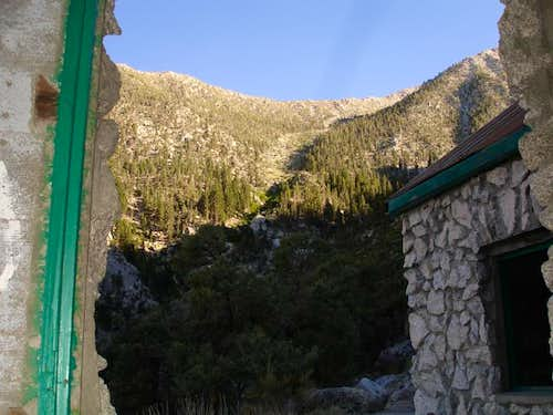 Avalanche chute above stone house
