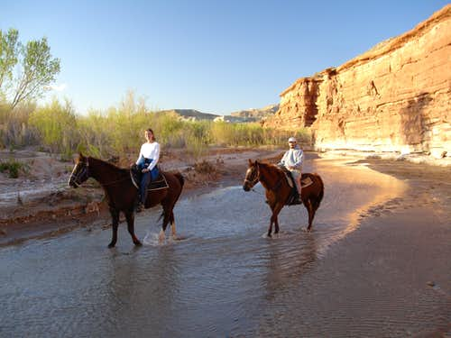My wife and I horseback riding in Escalante