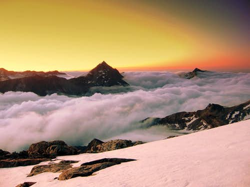 Sunrise from Allalinhorn Hohlaubgrat route.