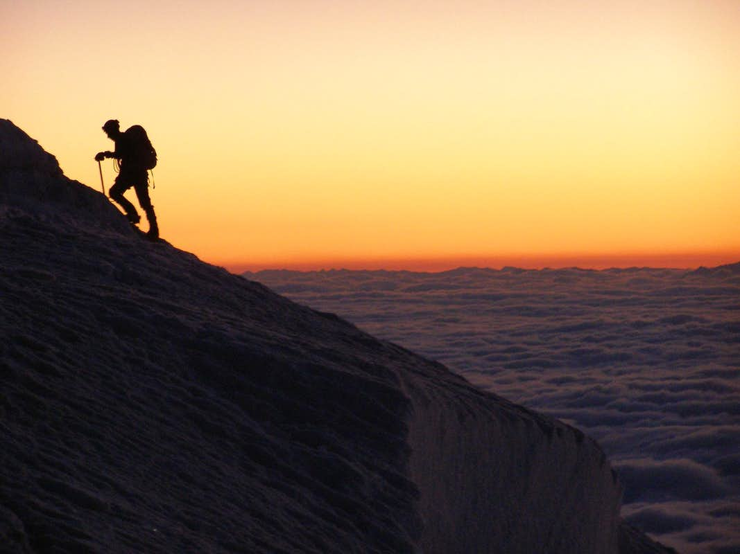 Early Morning Climber Above The Clouds