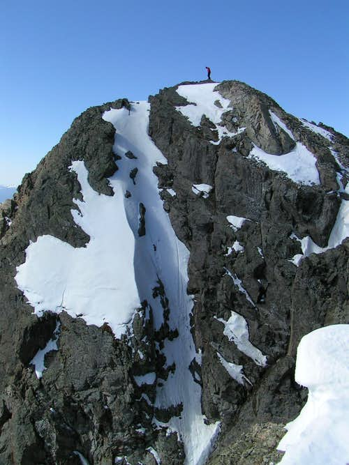 Lone climber looks out over Grizzly Peak 13,988\'