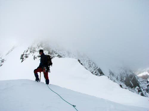 In snow storm on NE ridge of Roetspitze / Pizzo Rosso, 3495m.