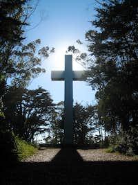An illuminated cross atop Mt. Davidson