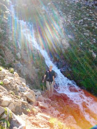 Lonny standing next to the stream we ascended next to