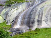 Beautiful waterfall near Grimsel storage lake