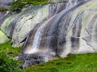 Beautiful waterfall near Grimsel storage lake