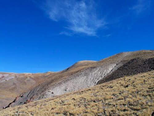 False peak on left (Delano is...
