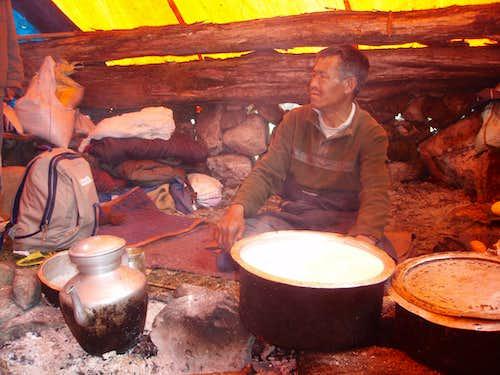 Yak herder making cheese