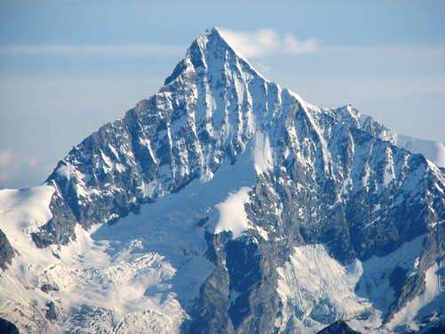 A mighty Weisshorn, 4506m seen from the ridge of Castor, 4229m..