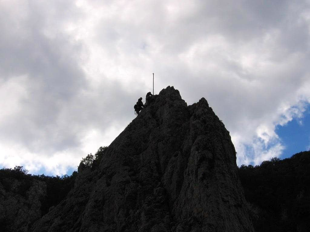 Climbers on the tower of Cukorová Homolá (Sugarloaf)