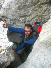 Monty at the top of the tunnel behind the chockstone