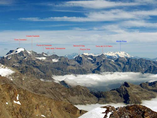 Panoramic view to the south side of WE main ridge of Gran Paradiso group.Photo taken from the summit of Uja di Ciamarella.