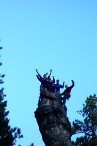 A crowded summit on a spire in the Needles South Dakota