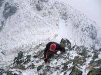 Erik climbing Soliskovy hrb (2129 m) during heavy winds