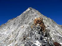 The summit of Monte Sissone.This is the south-est ridge.Strange red rocks conformations.