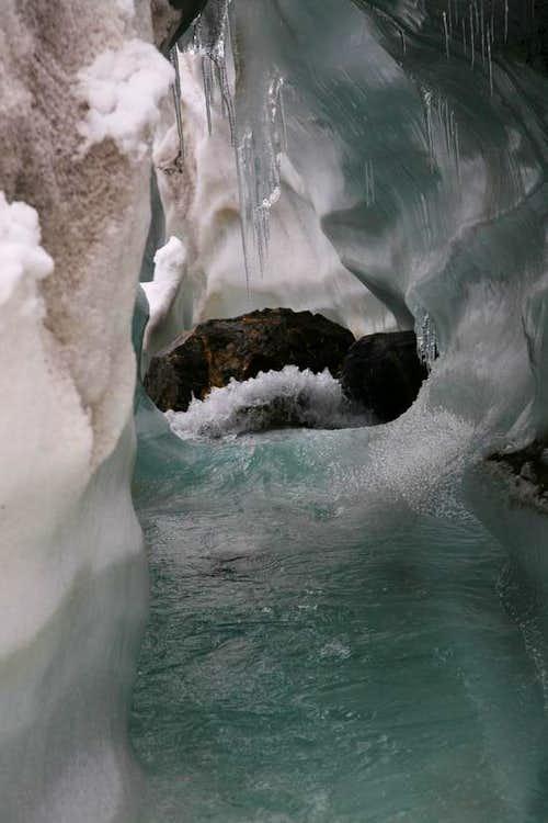 Stream flowing under the crevasse