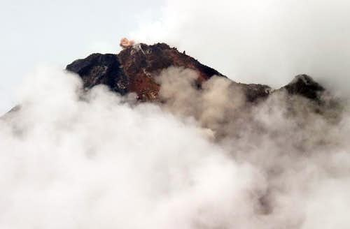 Arenal emits a small cloud of ash