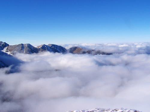 clouds on the summit of Volovec