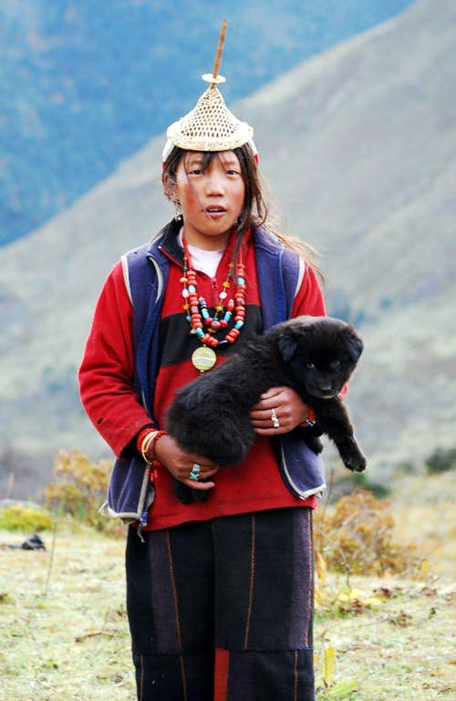Gasa woman with dog