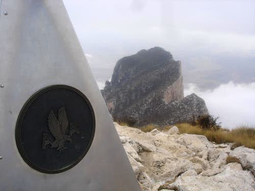 Guadalupe Summit Marker with El Capitan in background - winter