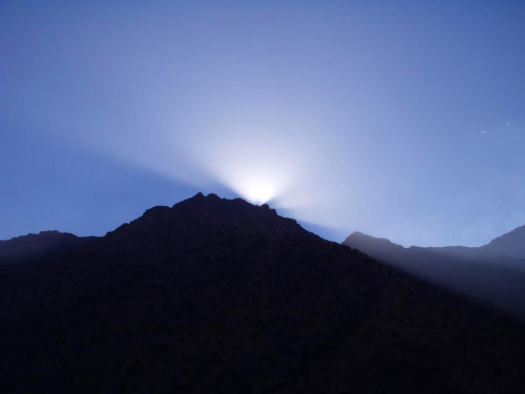 Sun disappears behind mountain
