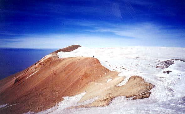 A climber near the summit of...