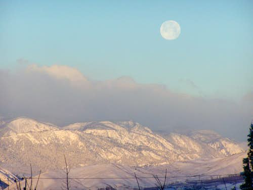 Moon setting Christmas Eve over Wenatchee