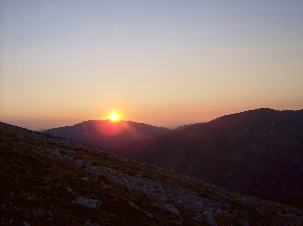 Sun peeking over Bald Mountain
