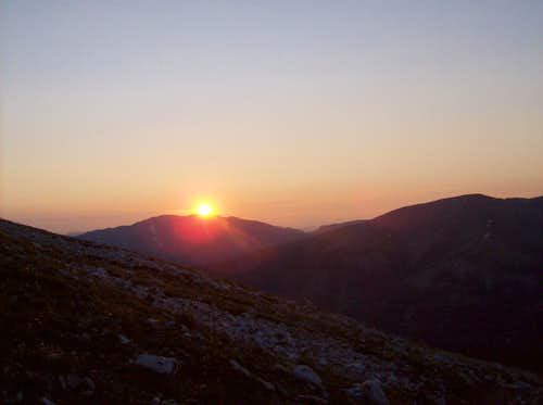 Sun peeking over Bald Mountain