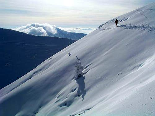 Tour skiing below Mozic,...