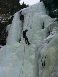 Mig rappeling the upper pitch