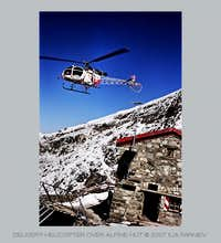 Delivery helicopter over Tracuit hut