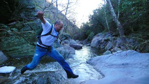 chuck jumping over a stream