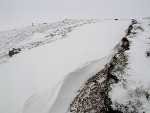 Snow drifts en route up Glas Maol