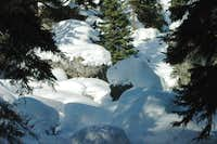 Shadows over Snowy Boulders