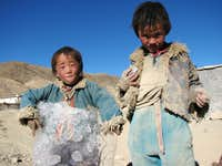 Tibetan children playing with ice...