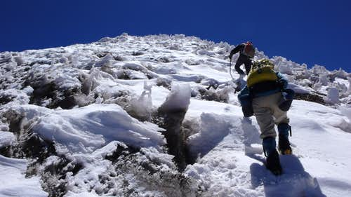 Climbing snow field high on Catedral