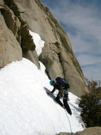 Crossing a snowfield on a winter ascent of Autumn Ledges