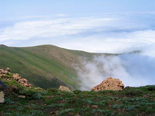 Ridgeline descending into clouds