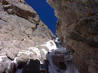 Climbing through pitch 4 on Martha
