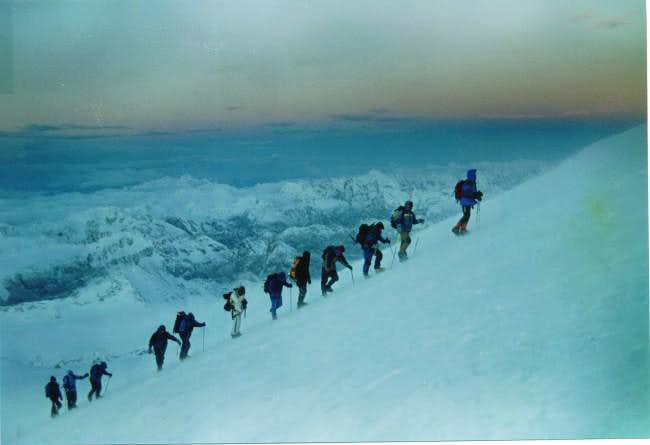 Climbers inch their way up...