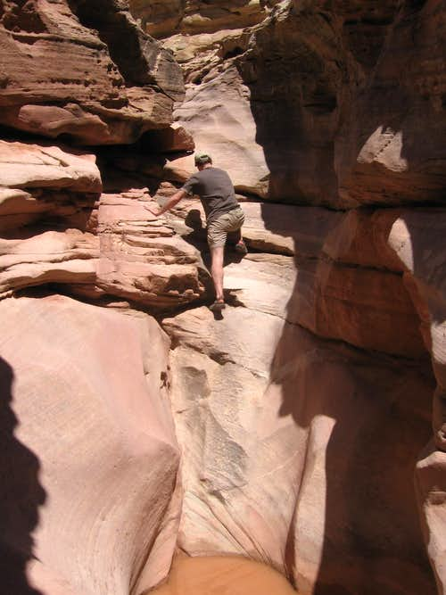 scrambling above the potholes in Ding Canyon